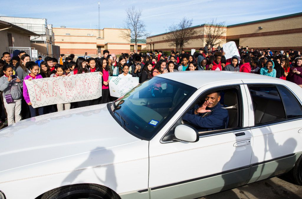 Coach Kevin MaBone is surprised with a car during a presentation by students and teachers on Friday, January 20, 2017 outside Wilkinson Middle School in Mesquite, Texas. MaBone was diagnosed with cancer, and had to rely on teachers to get to and from work and to cancer treatments. The school raised money to buy a car and gift it to MaBone. (Ashley Landis/The Dallas Morning News)