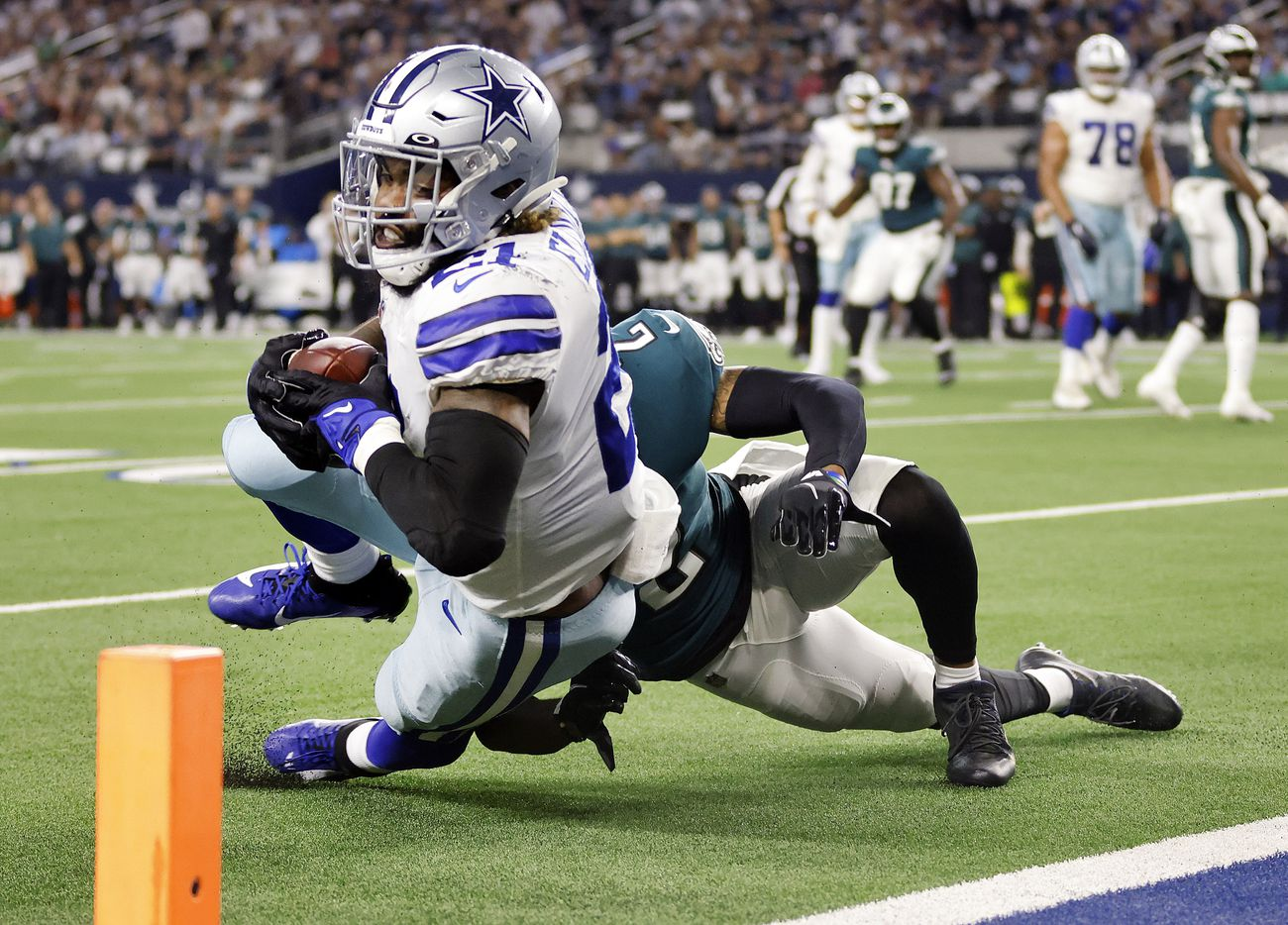 Dallas Cowboys running back Ezekiel Elliott (21) dives for the pylon but comes up short as he's tackled by Philadelphia Eagles cornerback Darius Slay (2) during the first quarter at AT&T Stadium in Arlington, Monday, September 27, 2021. The Cowboys would score a touchdown shortly thereafter. (Tom Fox/The Dallas Morning News)