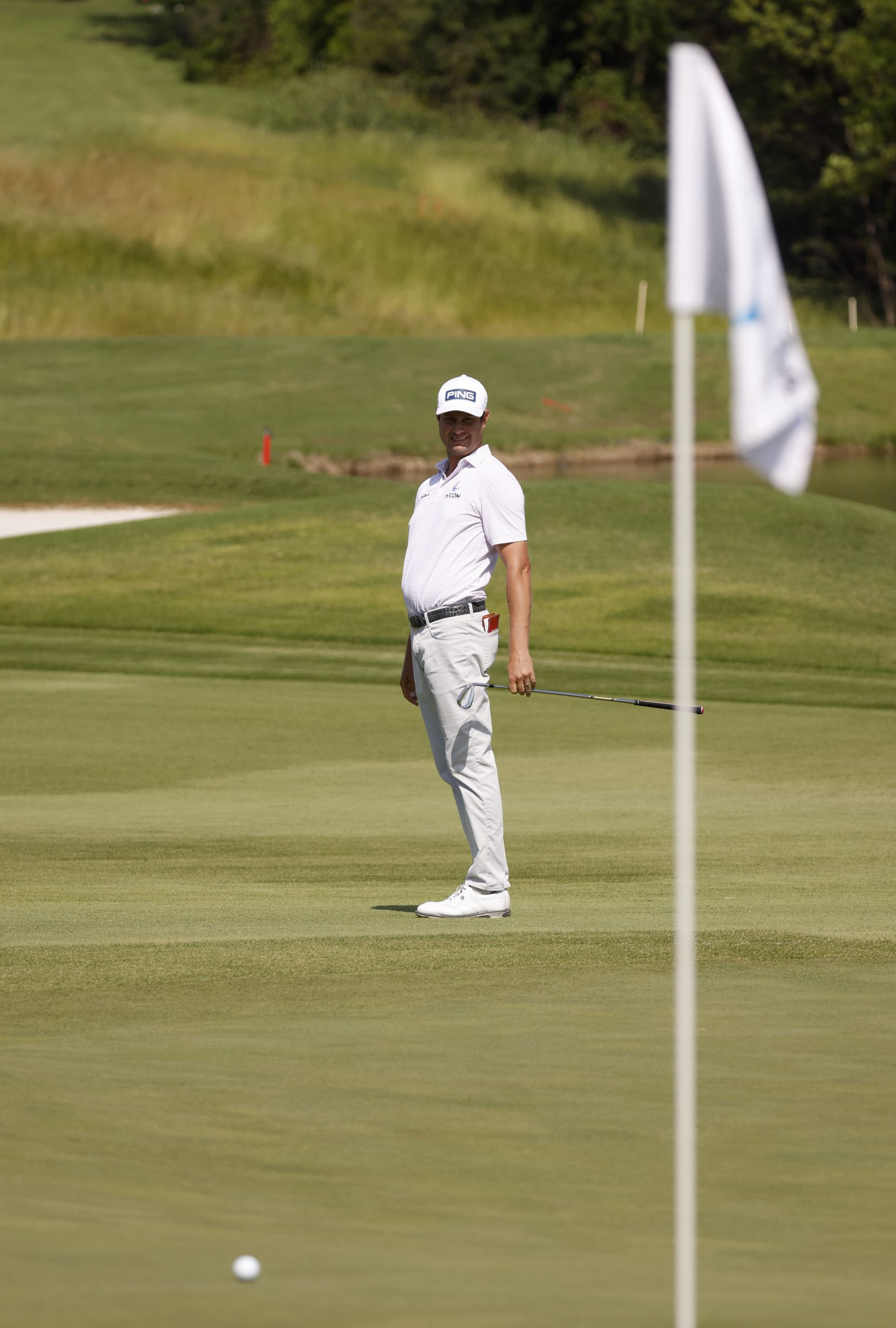 Harris English watches his ball on the 14th hole during round 3 of the AT&T Byron Nelson  at TPC Craig Ranch on Saturday, May 15, 2021 in McKinney, Texas. (Vernon Bryant/The Dallas Morning News)