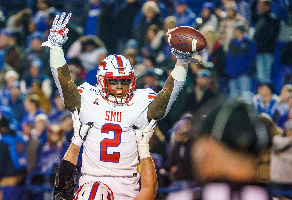 SMU running back Ke'Mon Freeman (2) celebrates after scoring on a 2-yard touchdown run during the second half of an NCAA football game against Memphis at Liberty Bowl Memorial Stadium on Saturday, Nov. 2, 2019, in Memphis, Tenn. (Smiley N. Pool/The Dallas Morning News)