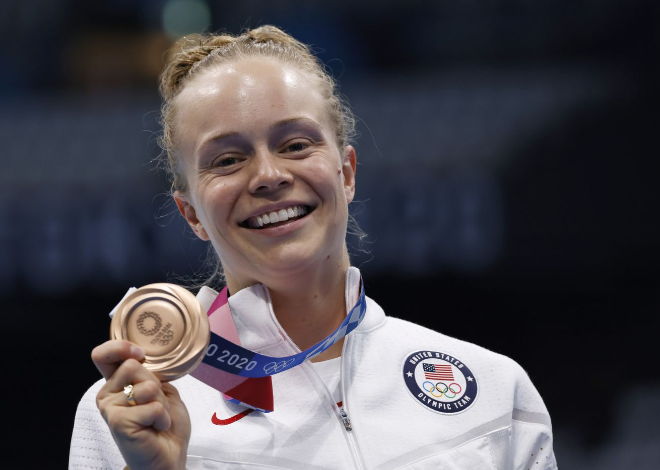 USA's Krysta Palmer poses for photographers with her bronze medal after competing in the women's 3 meter springboard final during the postponed 2020 Tokyo Olympics at Tokyo Aquatics Centre, on Sunday, August 1, 2021, in Tokyo, Japan. Palmer finished 3rd with a total score of 343.75 to earn a bronze medal. (Vernon Bryant/The Dallas Morning News)