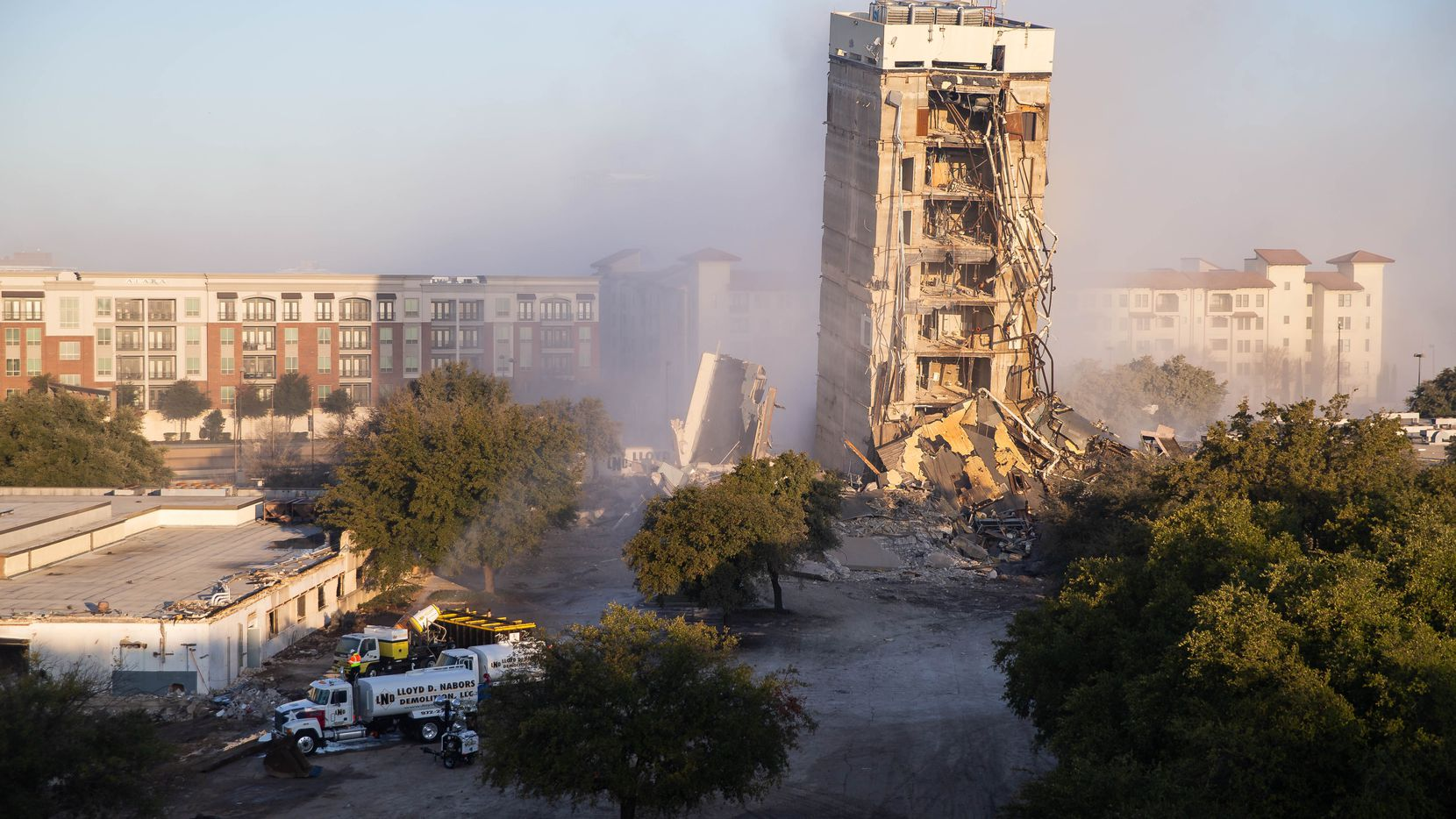 Part of the 11-story former Affiliated Affiliated Computer Services tower remains standing after an implosion attempt north of downtown Dallas on Feb. 16, 2019. (Juan Figueroa/The Dallas Morning News)