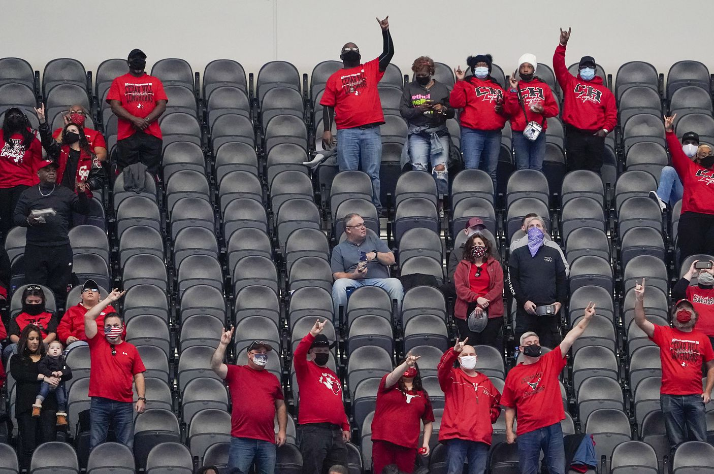 Cedar Hill fans stand for their school song before the Class 6A Division II state football championship game against Katy at AT&T Stadium on Saturday, Jan. 16, 2021, in Arlington, Texas.