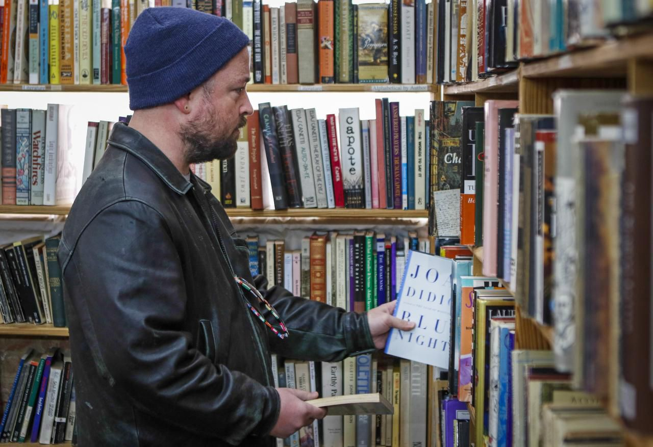 Oak Cliff resident Tim Kerlin peruses the shelves. Lucky Dog Books' space has been leased to Common Desk, a Deep Ellum-based company that rents work areas to small businesses.