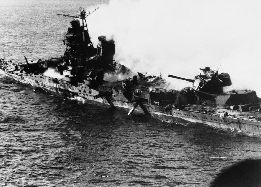 A Mogami-class Japanese cruiser is the flaming target of carrier-based U.S. naval aircraft during the Battle of Midway in 1942.