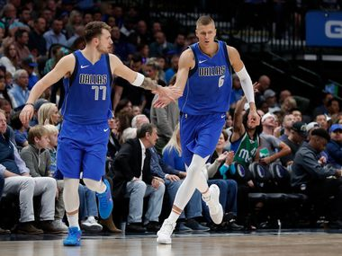 Dallas Mavericks' Luka Doncic (77) and Kristaps Porzingis (6) celebrate a basket by Porzingis in the second half of an NBA basketball game against the Portland Trail Blazers in Dallas, Sunday, Oct. 27, 2019.
