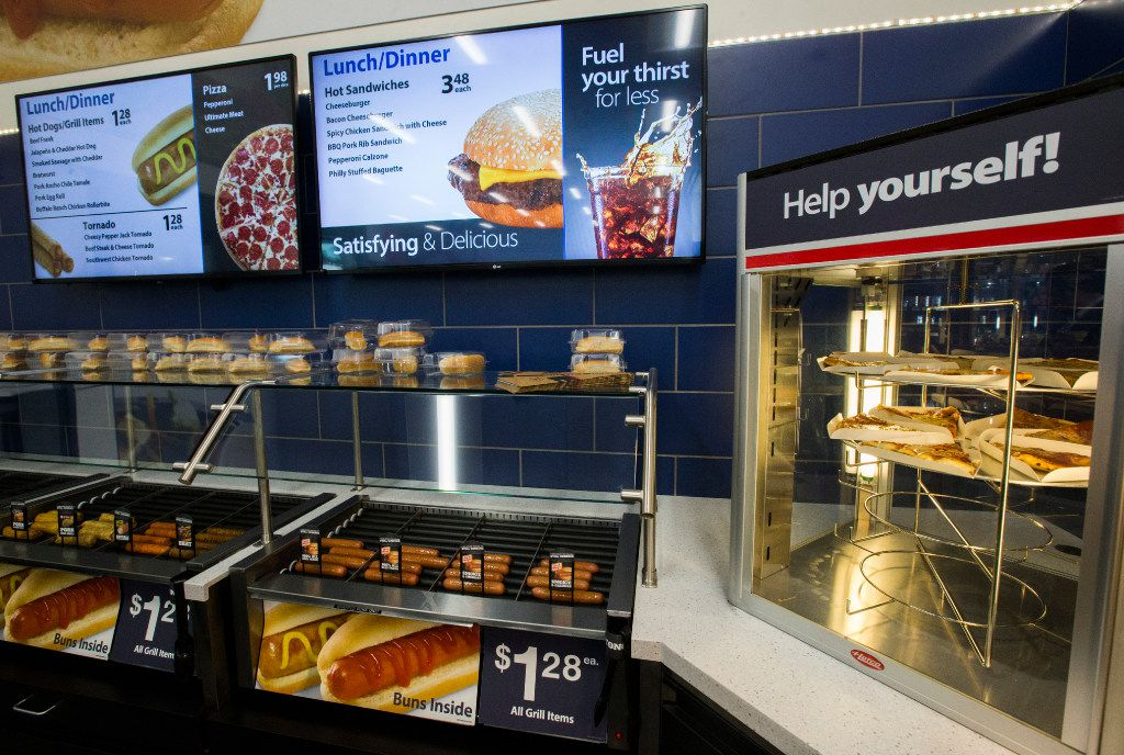 Pizza and hot dogs cook in the hot foods section of a new Walmart convenience store on Wednesday, February 8, 2017 on FM 1187 in Crowley, Texas. (Ashley Landis/The Dallas Morning News)