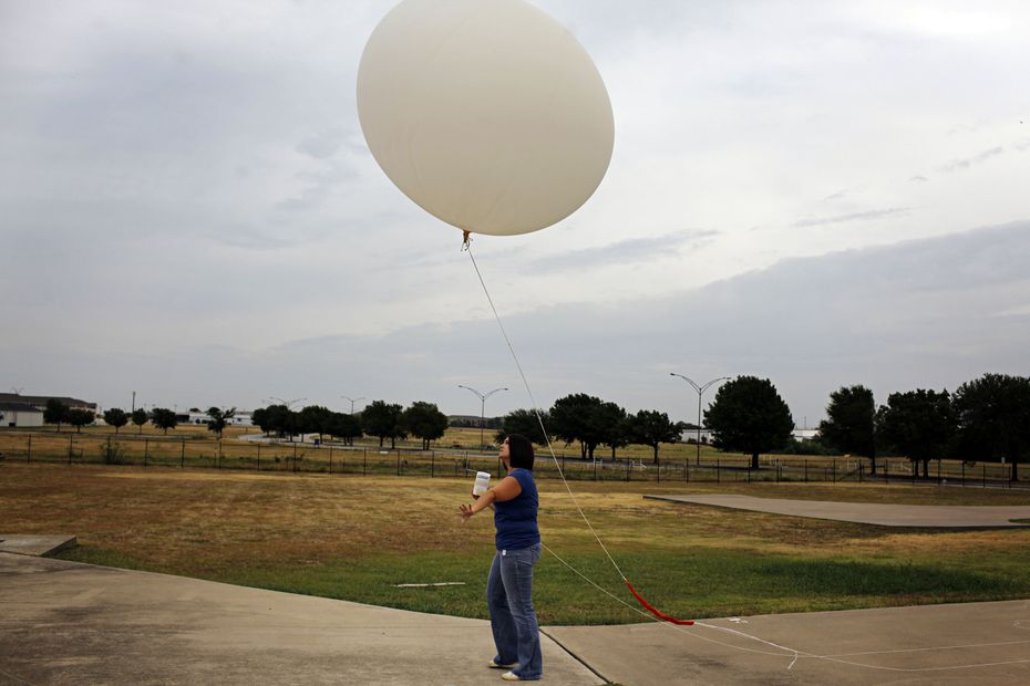 Amber Elliott, a meteorologist with the National Weather Service, released a weather balloon  in Fort Worth in 2011.