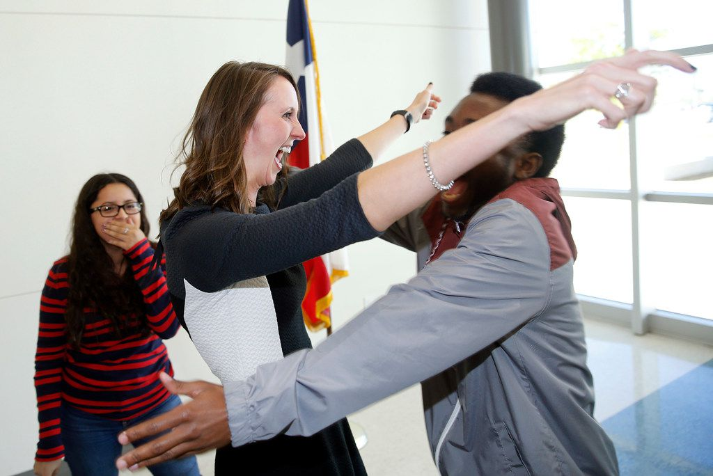 Arlington Collegiate High School teacher Jennifer Fuller (center) is congratulated on winning the coveted Milken Educator Award by her senior students Michael Barnes (right) and Siomara Salazar following an assembly at the school in Arlington, Texas, Wednesday, October 18, 2017. Forty five educators across the country received the award this year, two in Texas. (Tom Fox/The Dallas Morning News)
