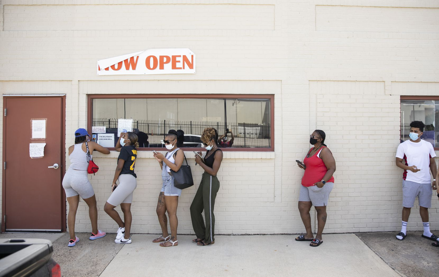Customers wait in line to order food at Turkey Leg Paradise.