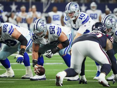 Dallas Cowboys quarterback Cooper Rush (10) takes a snap from center Connor Williams (52) during the first half of a preseason NFL football game against the Houston Texans at AT&T Stadium on Saturday, Aug. 21, 2021, in Arlington.