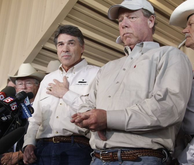 Then-Texas Gov. Rick Perry (left) appeared with West Mayor Tommy Muska after an explosion rocked the Central Texas community in April 2013.
