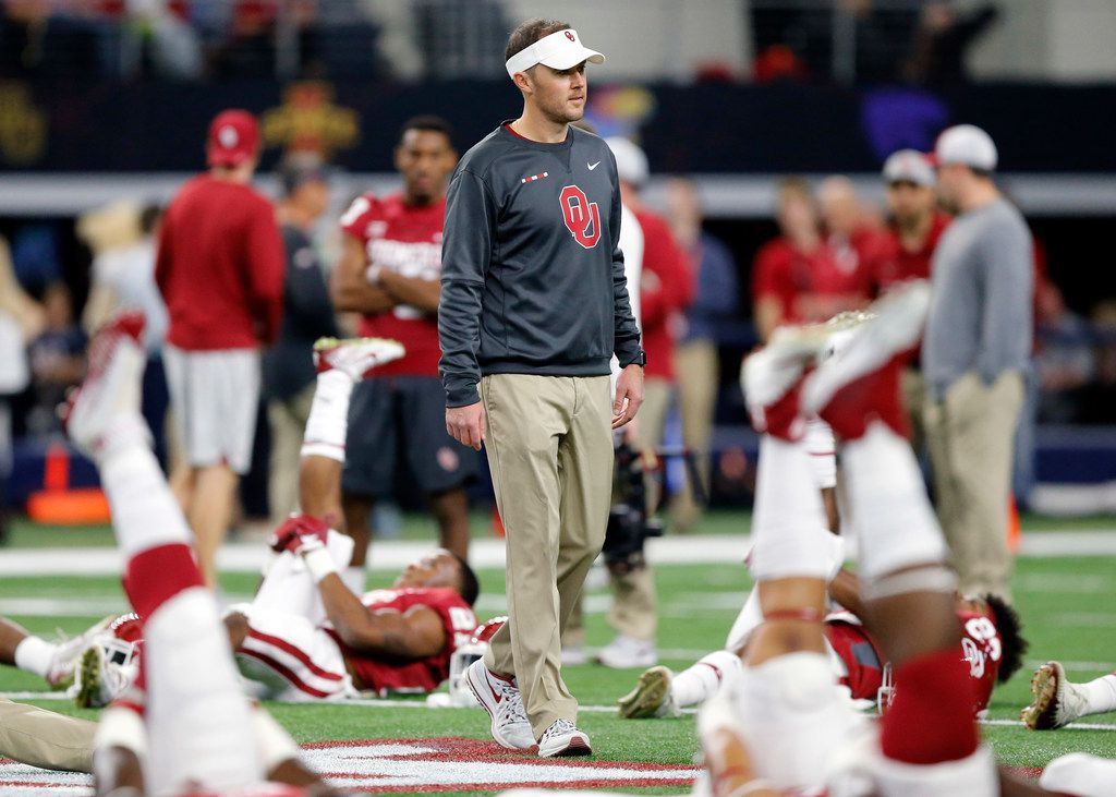 Oklahoma Sooners head coach Lincoln Riley watches his players stretch before their Big XII Championship game with the TCU Horned Frogs at AT&T Stadium in Arlington, Texas, Saturday, December 2, 2017.