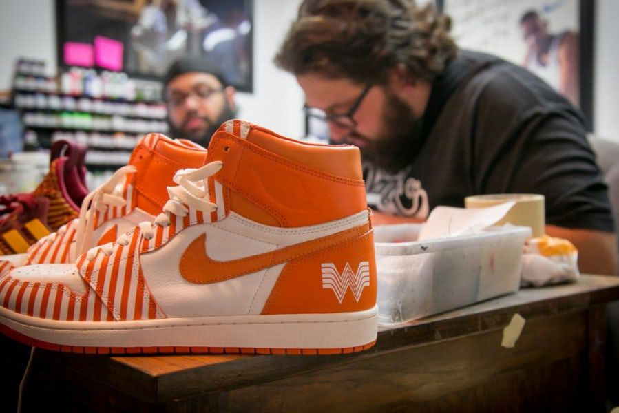 Whataburger commissioned three special pairs of sneakers by San Antonio shoe designer Jake Danklefs (right) for contest prizes in 2017.