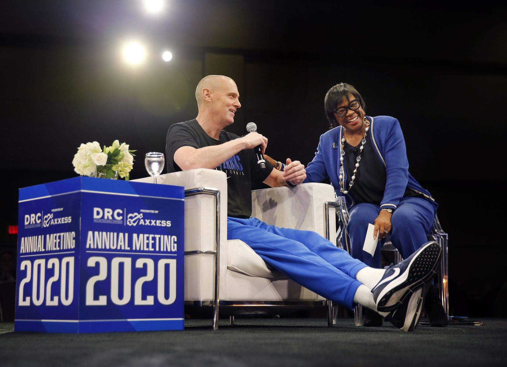 Dallas Mavericks CEO Cynt Marshall (right) laughs at team head coach Rick Carlisle as they participated in a keynote conversation at the Dallas Regional Chamber's annual meeting and luncheon at the Hilton Anatole hotel in Dallas on Thursday.