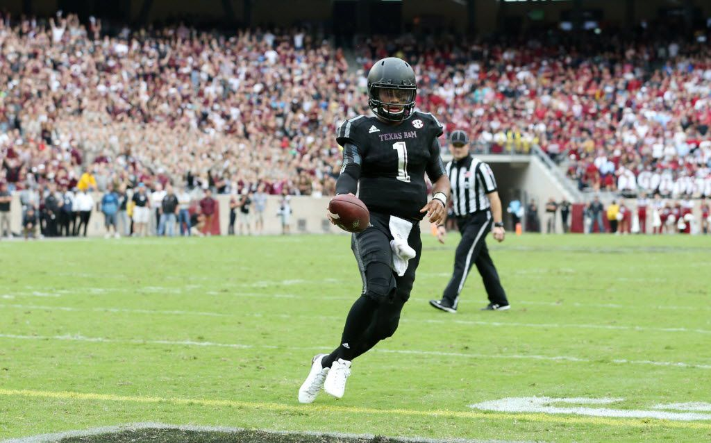 Texas A&M Aggies quarterback Kyler Murray (1) scores a touchdown off a run on a fourth down play during the second half of play at Kyle Field in College Station, on Saturday, October 31, 2015. Texas A&M Aggies defeated South Carolina Gamecocks 35-28. (Vernon Bryant/The Dallas Morning News)