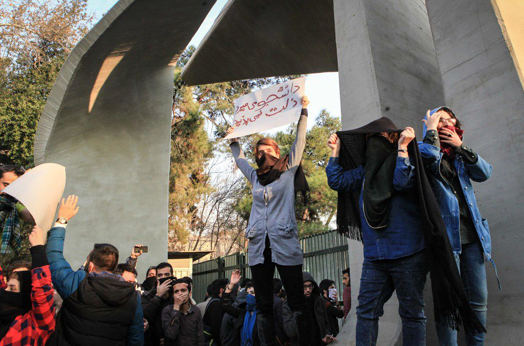 Iranian students protest at the University of Tehran during a demonstration driven by anger over economic problems, in the capital Tehran on December 30, 2017. Students protested in a third day of demonstrations sparked by anger over Iran's economic problems, videos on social media showed, but were outnumbered by counter-demonstrators. / AFP PHOTO / STRSTR/AFP/Getty Images