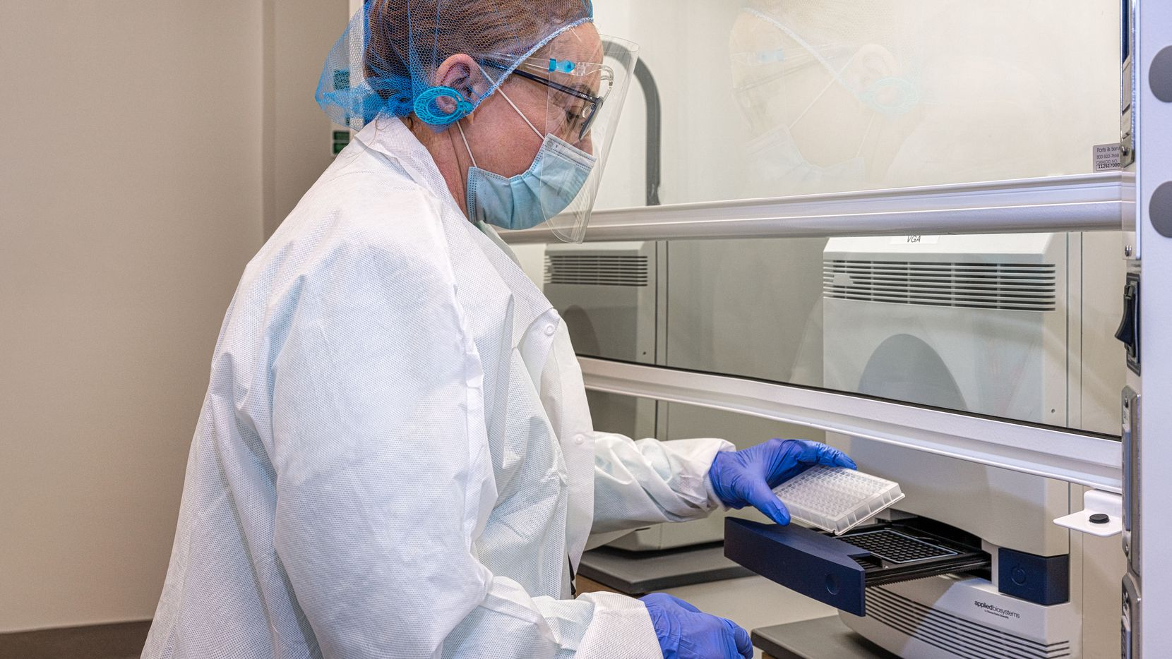 Dr. Florence Haseltine helps set up UT-Arlington's COVID-19 test facility at the North Texas Genome Center in Arlington, Texas.