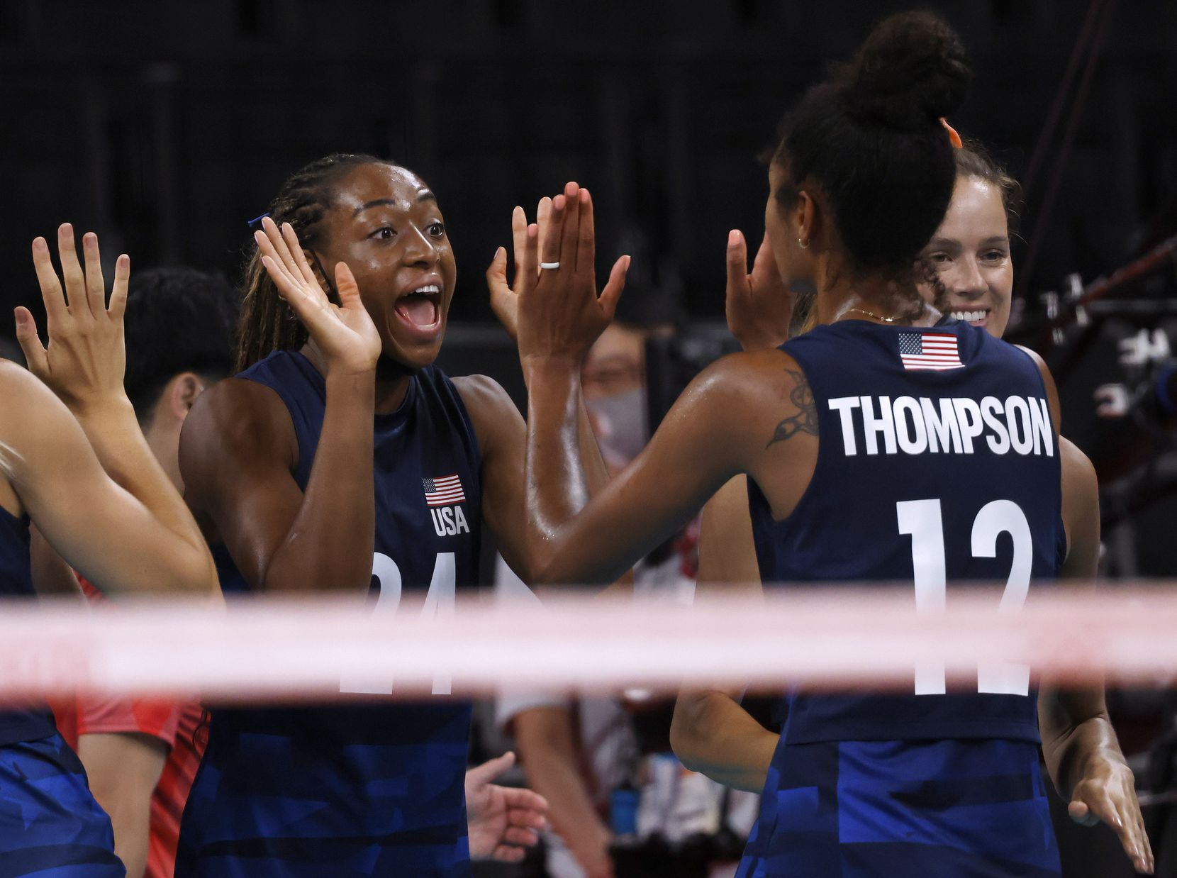 USA's Chiaka Ogbogu (24) celebrates with Jordan Thompson (12) after the team defeated Argentina in a women's volleyball game during the postponed 2020 Tokyo Olympics at Ariake Arena on Sunday, July 25, 2021, in Tokyo, Japan. USA defeated Argentina 3-0 (25-20, 25-19, 25-20). (Vernon Bryant/The Dallas Morning News)