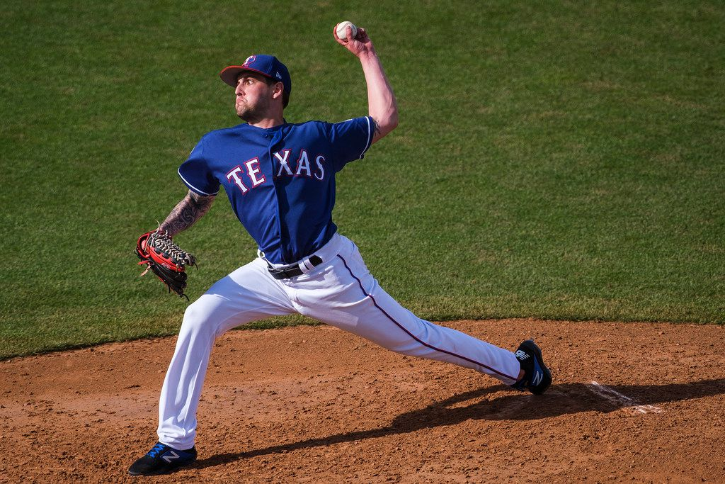 Texas Rangers pitcher Joe Palumbo pitches during a spring training baseball game against the Milwaukee Brewers at Surprise Stadium on Sunday, Feb. 24, 2019, in Surprise, Ariz.. (Smiley N. Pool/The Dallas Morning News)