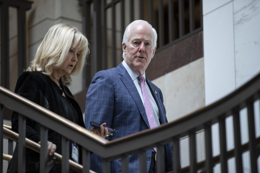 WASHINGTON, DC - MARCH 10: Sen. John Cornyn (R-TX) talks to a reporter as he heads into a briefing for Senators by officials from the Department of Homeland Security, Federal Bureau of Investigations, Director of National Intelligence, and the National Security Agency on the state of election security on Capitol Hill on March 10, 2020 in Washington, DC. (Photo by Samuel Corum/Getty Images)