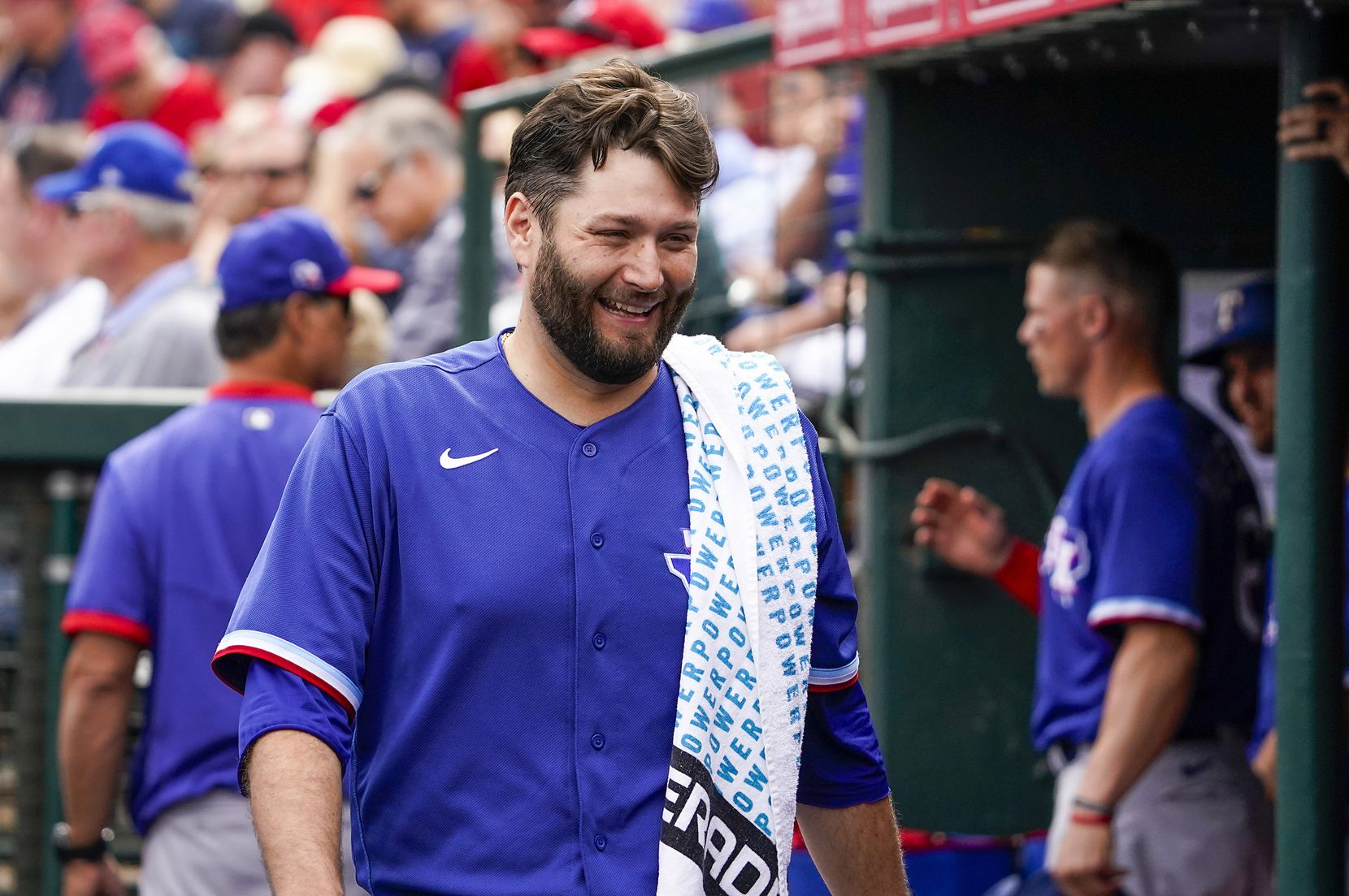 Texas Rangers pitcher Lance Lynn laughs with teammates in the dugout during the second inning of a spring training game against the Los Angeles Angels at Tempe Diablo Stadium on Friday, Feb. 28, 2020, in Tempe, Ariz.