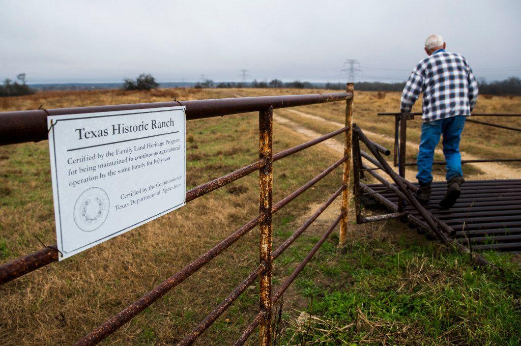 John Stoneham opens a gate at his ranch. (Ashley Landis/The Dallas Morning News)