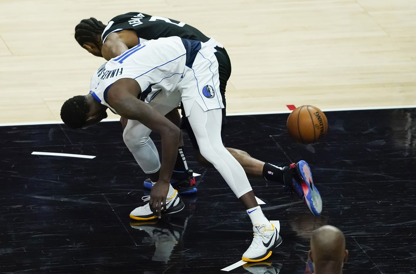 Dallas Mavericks forward Dorian Finney-Smith (10) knocks the ball away from LA Clippers forward Kawhi Leonard (2) during the fourth quarter of an NBA playoff basketball game at the Staples Center on Wednesday, June 2, 2021, in Los Angeles. The Mavericks won the game 105-100. (Smiley N. Pool/The Dallas Morning News)