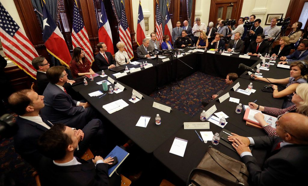 Texas Gov. Greg Abbott, at microphones at center, hosts a roundtable discussion to address safety and security at Texas schools in the wake of the shooting at Santa Fe. Two dozen groups were invited to attend the session, which was expected to include conversations on monitoring students' mental health.