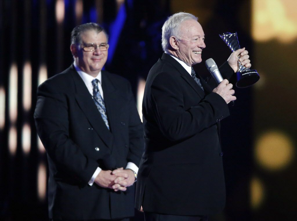 Dallas Cowboys owner Jerry Jones holds up an award he was given during the 2015 Academy of County Music Awards Sunday, April 19, 2015 at AT&T Stadium in Arlington, Texas.
