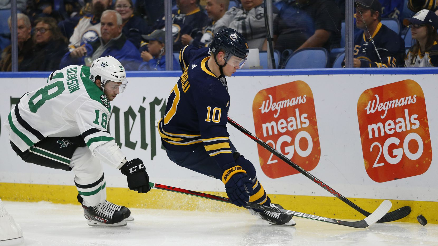 Buffalo Sabres defenseman Henri Jokiharju (10) and Dallas Stars forward Jason Dickinson (18) battle for the puck during the second period of an NHL hockey game, Monday, Oct. 14, 2019, in Buffalo N.Y.