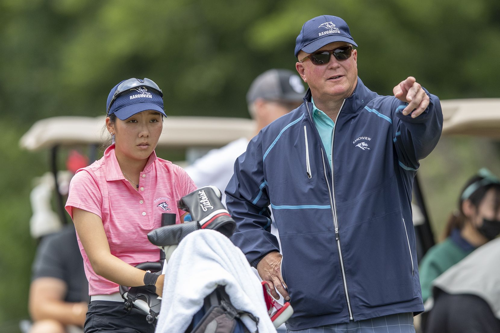 Carrollton Ranchview's Bohyun Park speaks with head coach Kevin Kelson on the 12th tee box during the final day of the UIL Class 4A girls golf tournament in Kyle, Tuesday, May 11, 2021. (Stephen Spillman/Special Contributor)