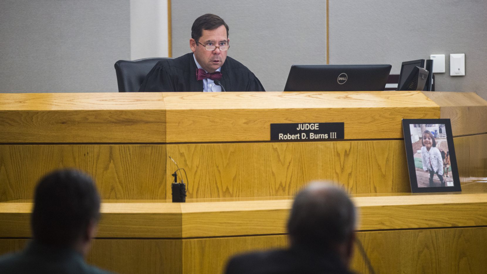 A photo of Leiliana Wright rested near Judge Robert D. Burns III during the final day of the trial of Charles Phifer (left), who was found guilty of capital murder in the March 2016 beating death of the 4-year-old.