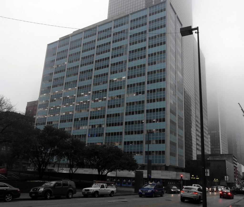 The Alto 211 building on North Ervay Street in downtown Dallas was renovated by Mike Sarimsakci's company. (Ron Baselice/Staff Photographer)