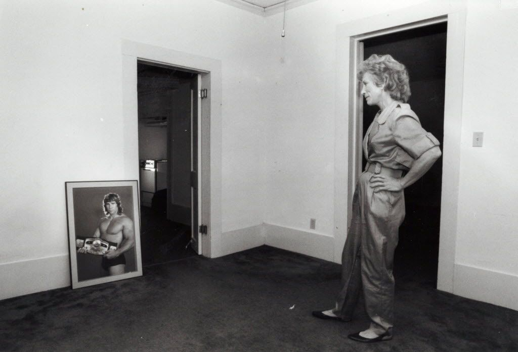 Doris Adkisson, mother of the Von Erich wrestling boys, stares at a picture of her son Kerry, the latest of her boys to die under tragic circumstances, while in a house that she had bought for him to live in, in Jefferson, Texas where she also lives, in April, 1993. (Randy Eli Grothe/The Dallas Morning News)