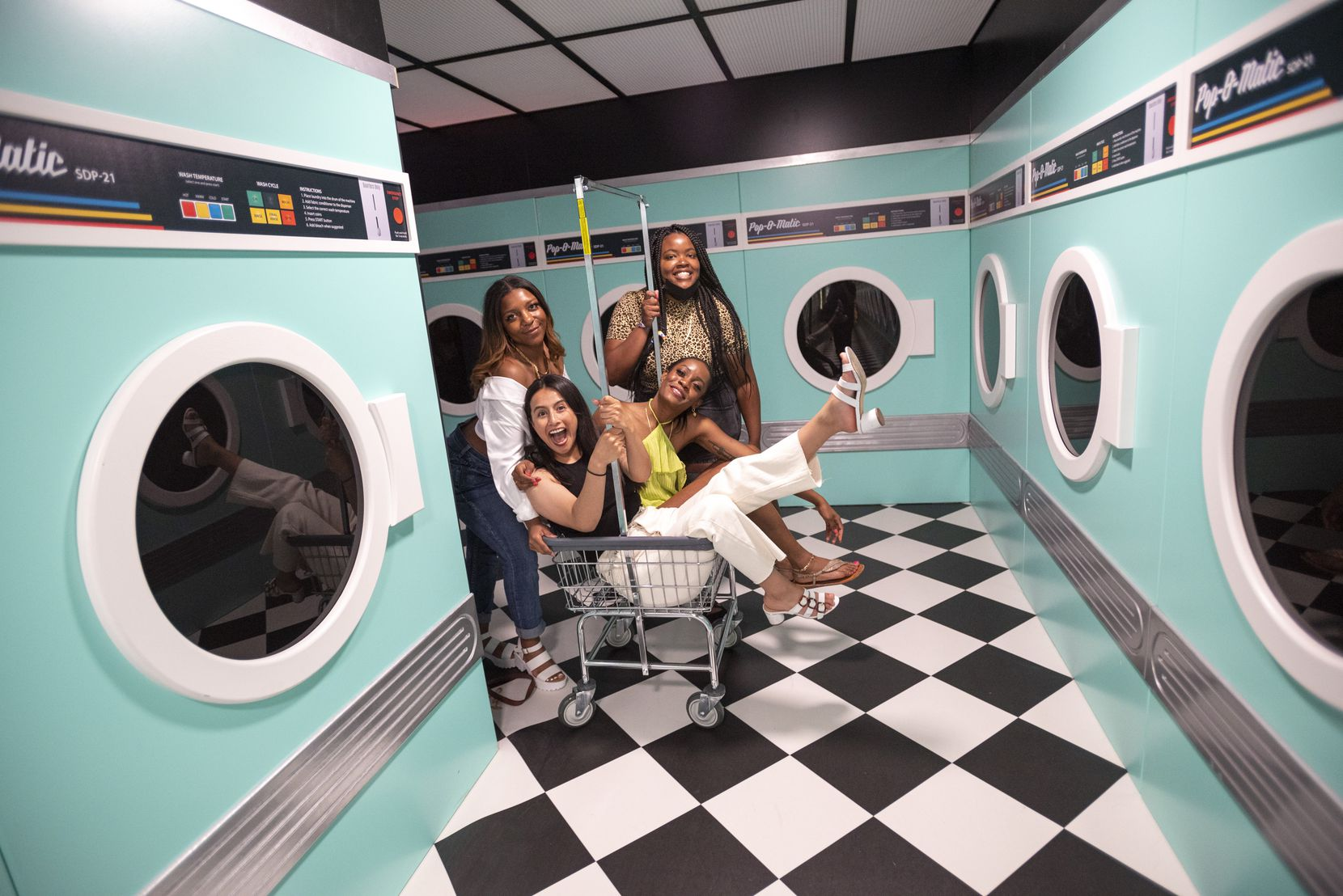 A laundromat scene puts a different spin on photos. From left are Karrington Jackson, Miriam Acosta, Veangele Williams and Morgan Evans.