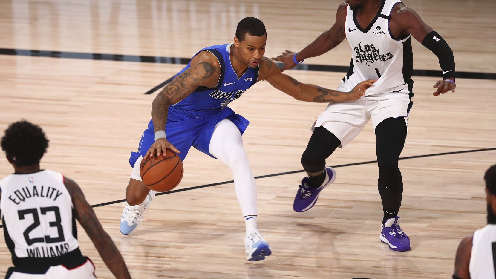 Dallas Mavericks guard Trey Burke (32) drives against Los Angeles Clippers guard Reggie Jackson (1) during the second half of Game 5 of an NBA basketball first-round playoff series, Tuesday, Aug. 25, 2020, in Lake Buena Vista, Fla.