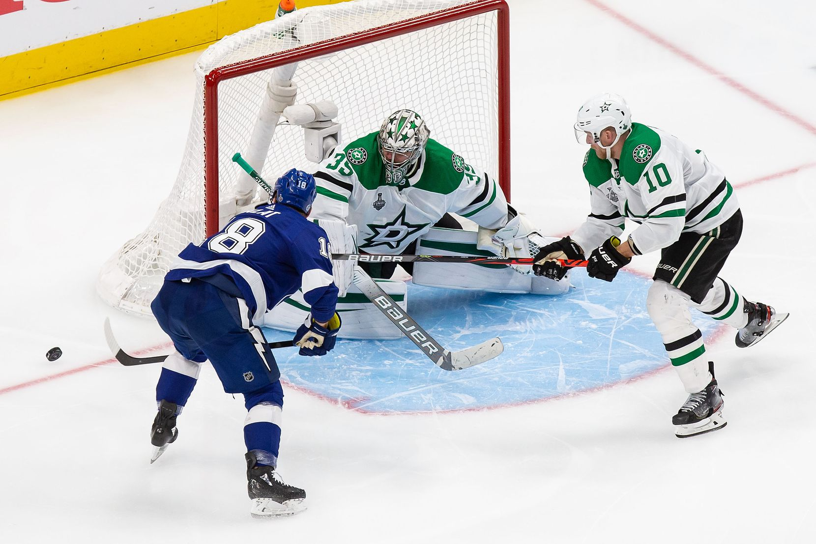 Corey Perry (10) and goaltender Anton Khudobin (35) of the Dallas Stars fend off Ondrej Palat (18) of the Tampa Bay Lightning during Game Two of the Stanley Cup Final at Rogers Place in Edmonton, Alberta, Canada on Monday, September 21, 2020. (Codie McLachlan/Special Contributor)
