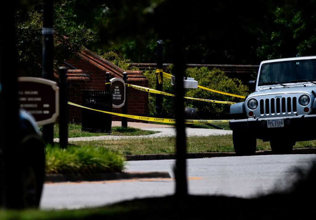 """Police tape is seen near building number 2 at the Virginia Beach Municipal Center, the scene of the mass shooting, in Virginia, Beach, Virginia on June 1, 2019. - A municipal employee sprayed gunfire """"indiscriminately"""" in the government building complex on May 31, 2019, police said, killing 12 people and wounding four in the latest mass shooting to rock the US. (Photo by Eric BARADAT / AFP)ERIC BARADAT/AFP/Getty Images"""