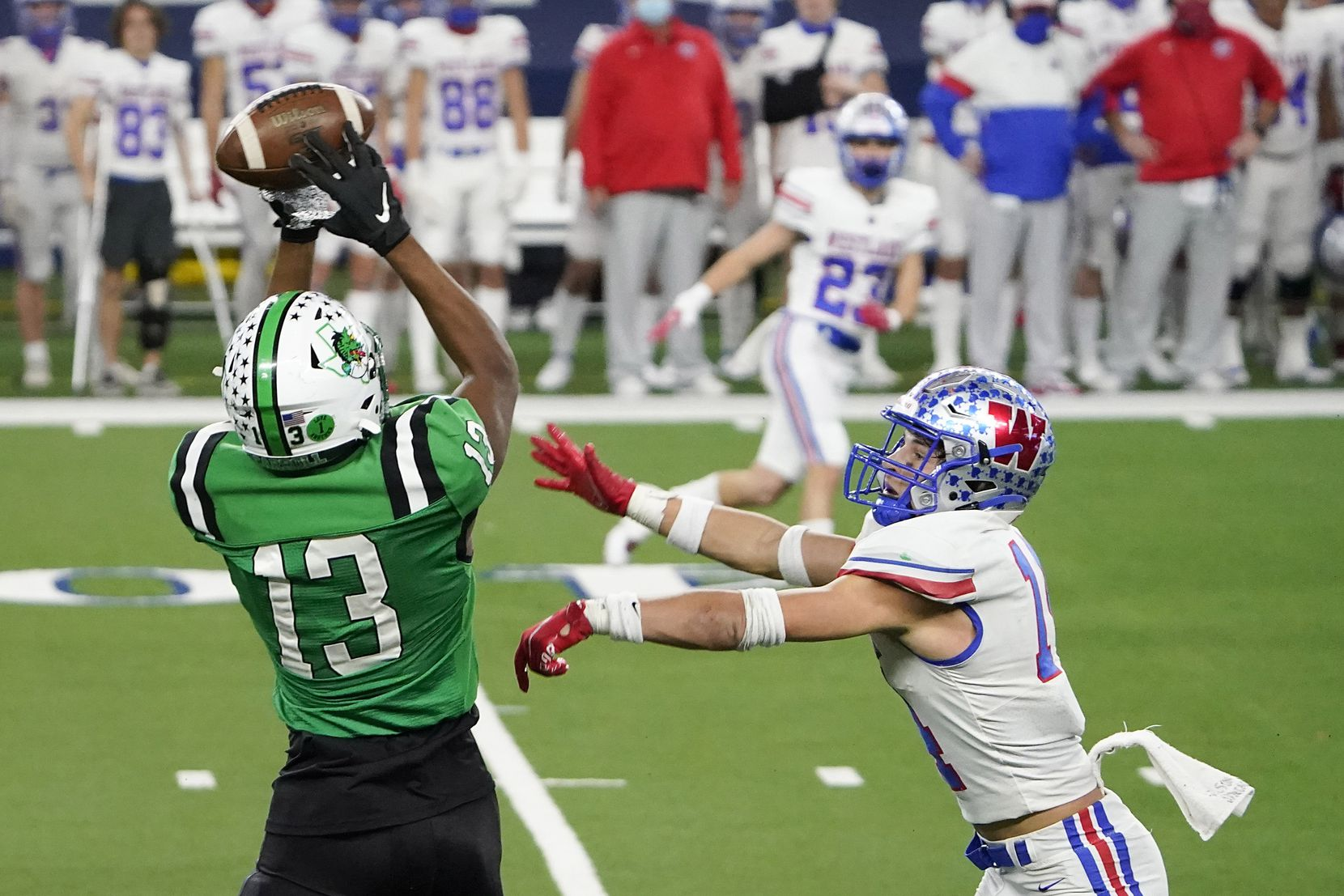 Southlake Carroll tight end RJ Maryland (13) catches a pass on a fourth down play over Austin Westlake defensive back Michael Taaffe (14) during the fourth quarter of the Class 6A Division I state football championship game at AT&T Stadium on Saturday, Jan. 16, 2021, in Arlington, Texas. Westlake won the game 52-34.