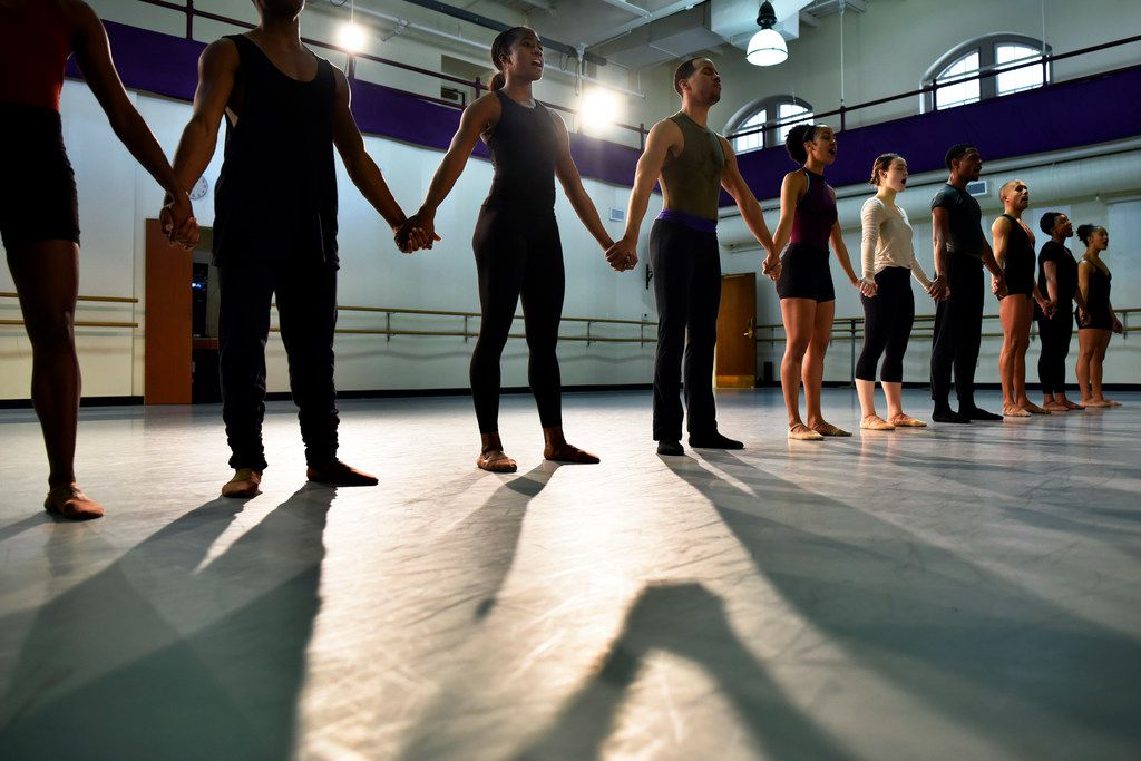 Dallas Black Dance Theatre company members hold hands during the opening moments of a run-through of Bodies as Site of Faith and Protest. Using songs, speeches and fiercely physical movement language, Philadelphia choreographer Tommie-Waheed Evans created the work as an embodiment of the struggles of the civil rights movement.