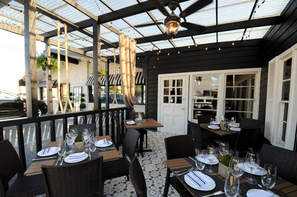 Guests can be seated on a covered patio at Pink Magnolia.