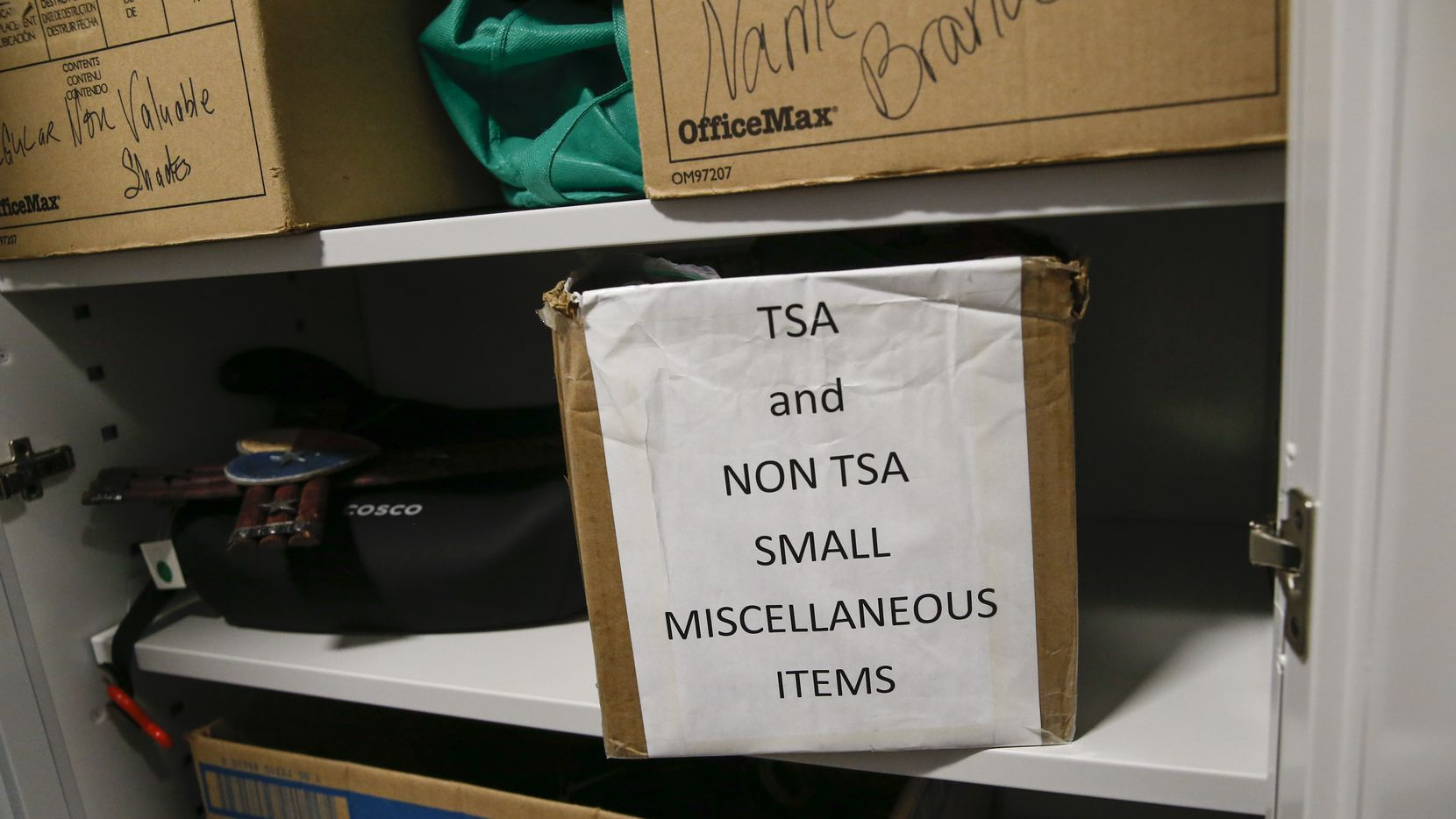 Items line the shelves of the lost and found office at Dallas Love Field.