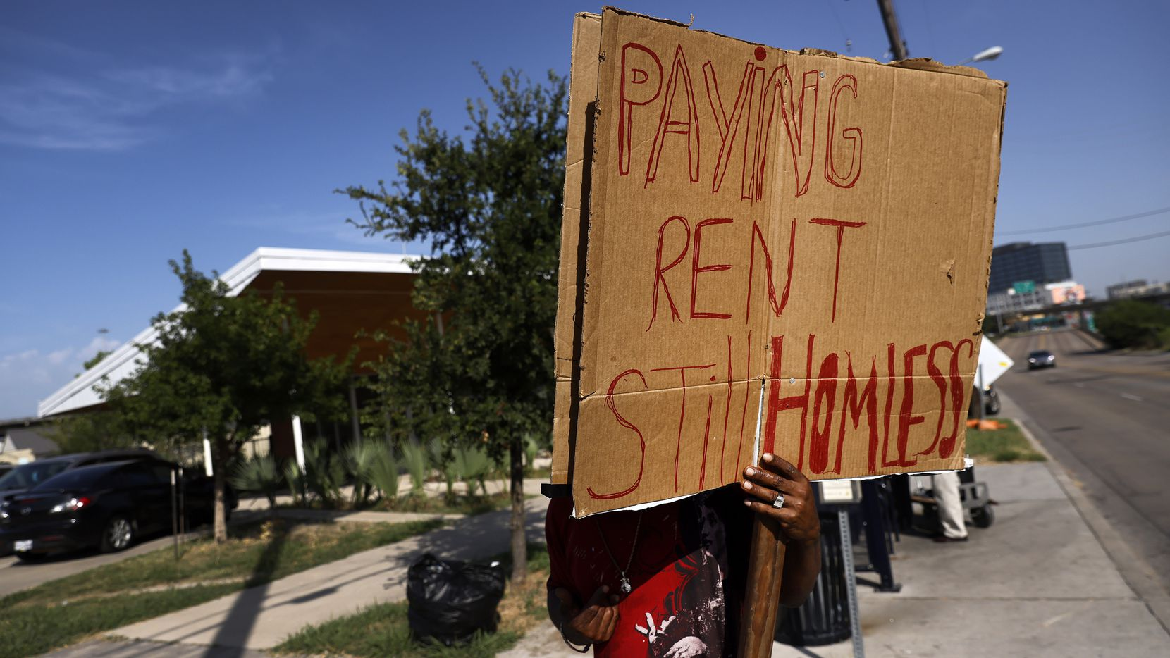David Andrews protested July 27, 2021, outside The Cottages at Hickory Crossing where he lives near downtown Dallas. He feels that the Cottages misled him on their policies when he signed a lease there.