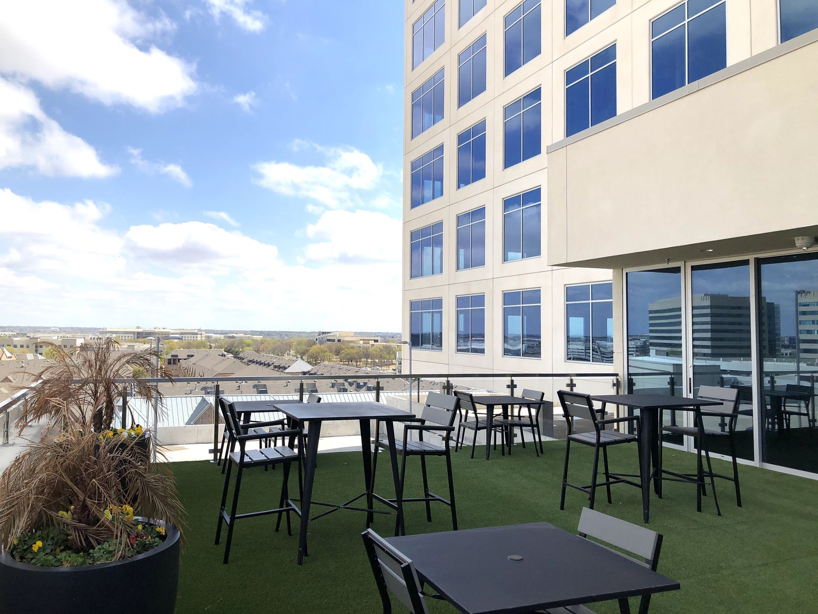 The new Headquarters II building in Plano has a seventh floor tenant lounge and patio.