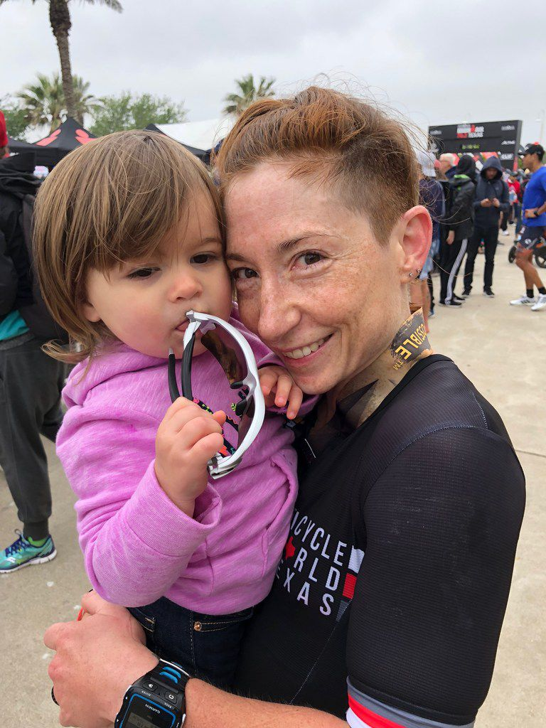 Brandi Grissom Swicegood, an Austin writer, and her daughter, Adaline, at the end of the 2018  Ironman Texas 70.3 in Galveston. She is capturing life's moments as she balances family and relationships while training to become a professional triathlete.