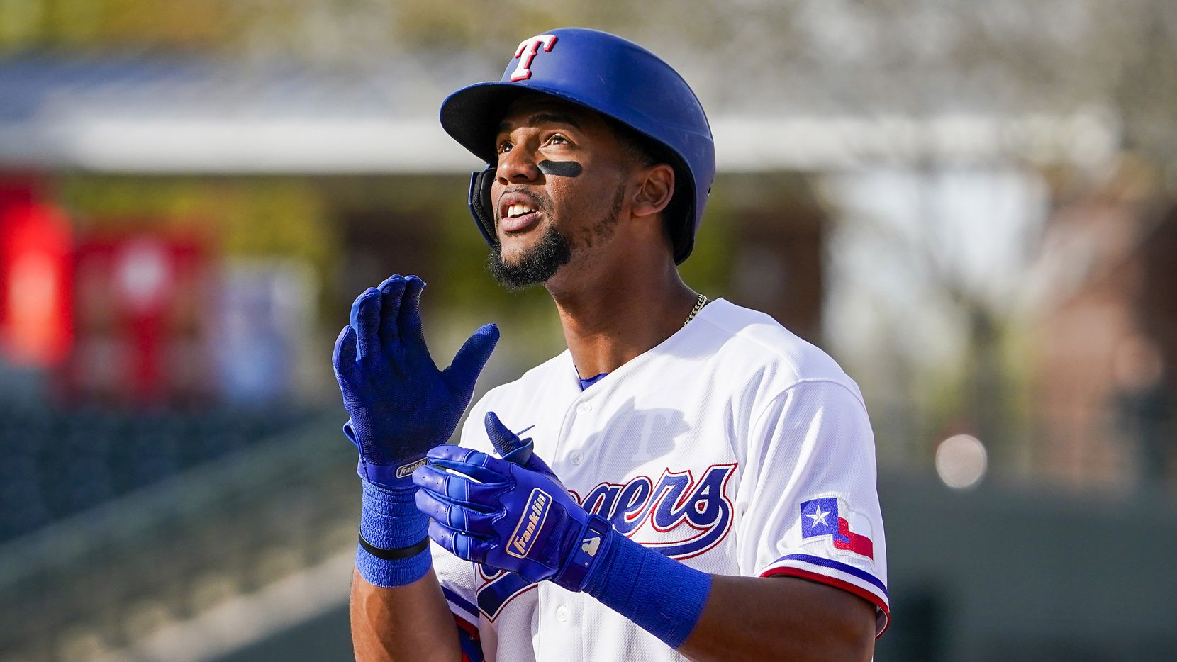 Rangers outfielder Leody Taveras celebrates after reaching base on a single during the eighth inning of a spring training game against the Chicago Cubs at Surprise Stadium on Thursday, Feb. 27, 2020, in Surprise, Ariz.