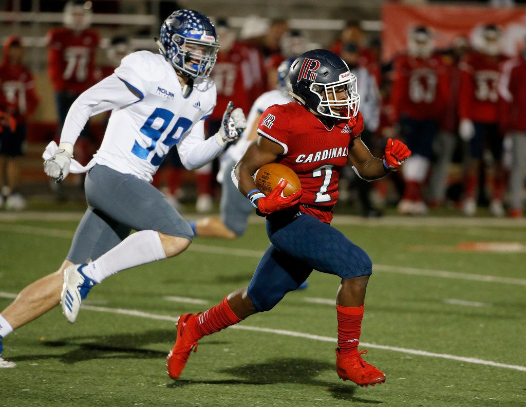 John Paul II's Myles Parker (2) runs a kick back as he is chased by Nolan's Kaleb James (99) during the first half of their TAPPS Division I second-round high school football playoff game in Grapevine, Tx, Friday, Nov. 22, 2019. (Michael Ainsworth)