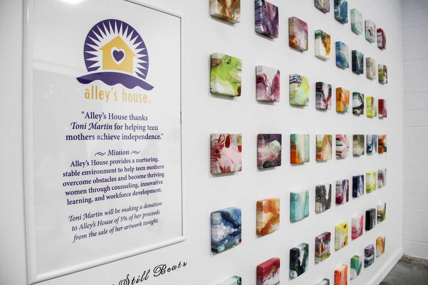 """Toni Martin's """"My Heart Still Beats"""" collection at her exhibit. The 7 x 7 inch squares are painted with abstract hearts. """"Whether your heart has been trampled on, or if your heart is beating loud, it is beating to the color of your soul,"""" Martin said."""