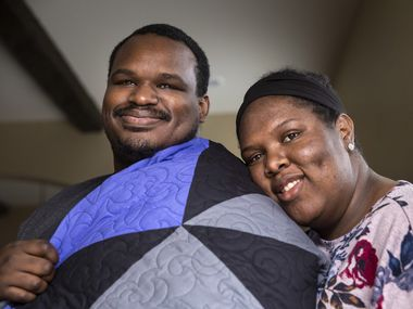Draped in the survivor's quilt made by his mother-in-law, Kerry Parks poses for a portrait with his wife, Katrina, at his in-laws' home in Irving.